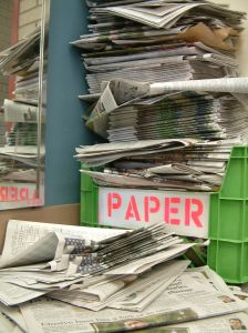 A picture of newspapers being recycled