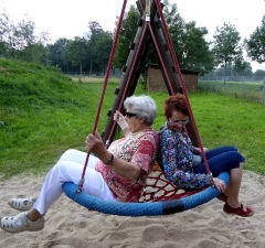old ladies on swing