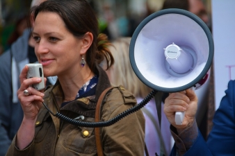 A picture of a woman using a megaphone