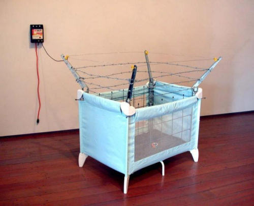 Funny Pictures of Baby Playpen with Barbed Wire