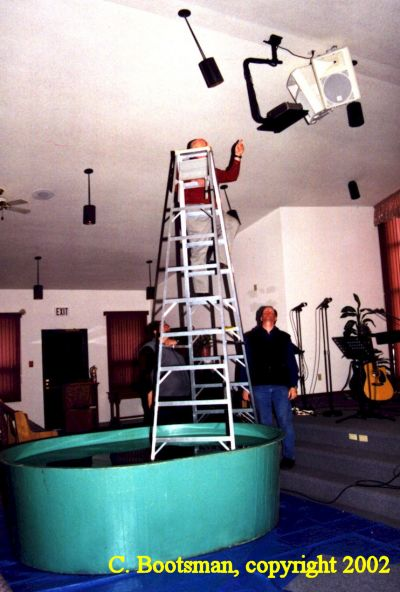Funny Pictures of Stepladder in Baptismal Tank