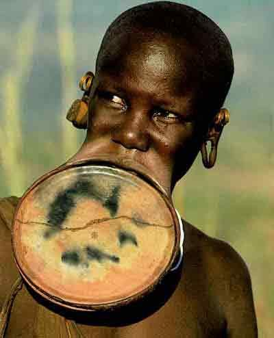 Funny Pictures of Man with Disc in Top Lip