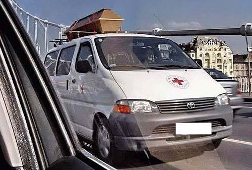 Funny Pictures of Casket on Red Cross Vehicle