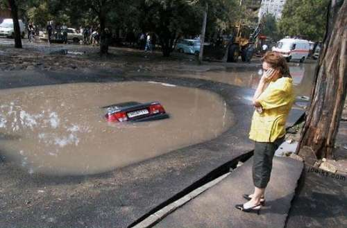 Funny Pictures of Car in Sink Hole