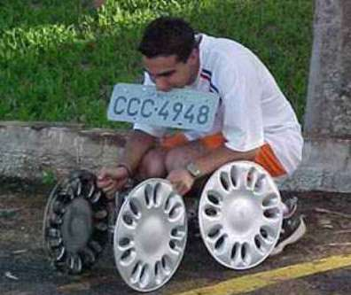 Funny Pictures of Teen with Hub Caps and License Plate