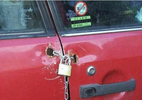 Funny Pictures of Padlock and Chain on Car Door