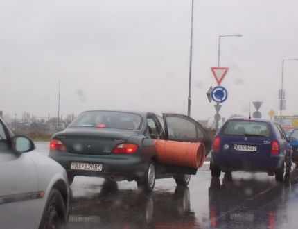 Funny Pictures of Pipe Sticking Out of Car