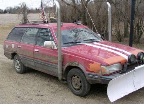 Funny Pictures of Car With Exhaust Stacks and Plow