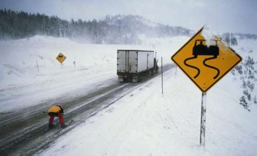 Funny Pictures of Skier Behind Truck On Icy Highway