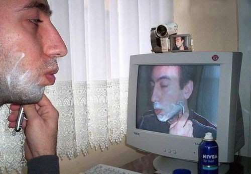 Funny Pictures of Man Shaving With Web Cam