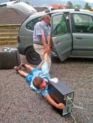 Funny Pictures of Kid Dragged to Summer Camp