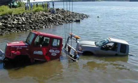 Funny Pictures of Tow Truck Half Submerged in Water.