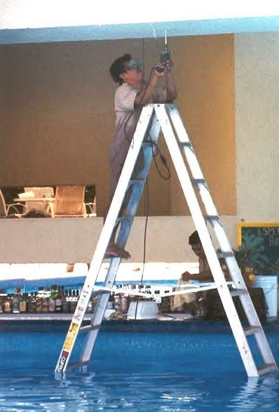 Funny Pictures of Worker on Aluminum Ladder in Pool