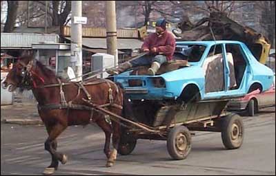 A funny picture of a horse pulling a car.