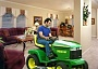 Funny Pictures of Man On Hoover Vacuum Tractor