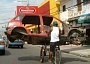 Funny Pictures of Bicycle Carrying Car Body