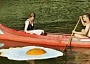 Funny Pictures of of Fried Egg Floating By Canoe Couple