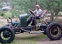 Funny Pictures of Old Jalopy Car and Lawn Chair