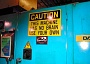 Funny Pictures of Caution Sign on Machine.