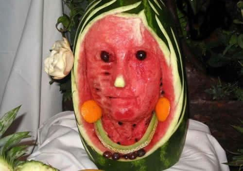 A picture of a face carved into a watermelon