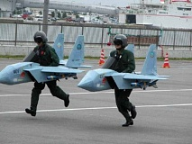 Funny Pictures of Pilots Running in Jet Fighters