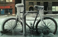 Funny Pictures of Bicycle Frozen and Locked to Pole.