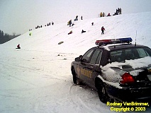Funny Pictures of Sheriff Watching Speeding Sledders