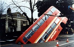 Funny Pictures of Double Decker Bus in Sink Hole