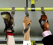 Funny Pictures of Foot in Hand Strap on Bus