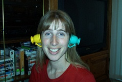 Funny Pictures of Girl with Tea Cups On Her Ears