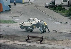 Funny Pictures of 3 Guys Pushing A Car Cart