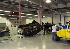 Funny Pictures of Car and Tow Truck in Auto Body Shop