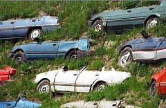 Funny Pictures of Junk Cars Buried in Hill
