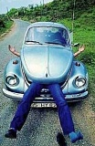 Funny Pictures of Volkswagen Bug Eating Man