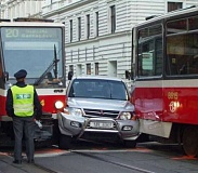 Funny Pictures of Car Squished Between Streetcars