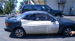 Funny Pictures of Car Repaired with Steel Roofing