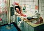 Funny Pictures of Guy Washing Dishes in Bath