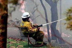 Funny Pictures of Fireman Sitting In Lawn Chair