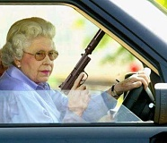 Funny Pictures of Queen Elizabeth with a Gun
