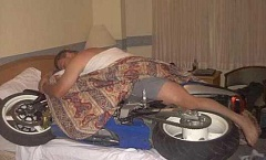 Funny Pictures of Man Sleeping With Motorcycle