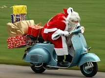 Funny Pictures of Santa Riding a Motorscooter