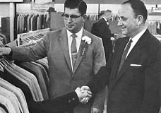 Funny Pictures of Suit Shaking Hands with Customer