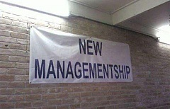 sign under new management