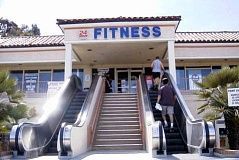 Funny Pictures of Fitness Sign By Escalators.