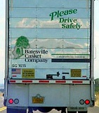 Funny Pictures of Drive Carefully Sign on a Casket Truck.
