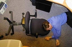 Funny Pictures of Man Sleeping on Office Floor