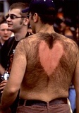 A picture of a Valentine heart chaeved into a guy's back.