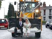 Funny Pictures of Bride and Groom in Tractor Bucket