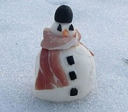 A snowman with a bacon scarf.
