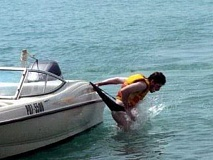 A funny boating pictures of a guy geting a wedgy